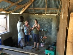 Clinic in Preskul - Morgan & Julie running the pharmacy
