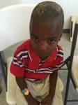 This poor little boy has a horrible infection on his head - one of just a dozen we see daily.