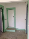 Doors leading to bathroom, exam room, and office